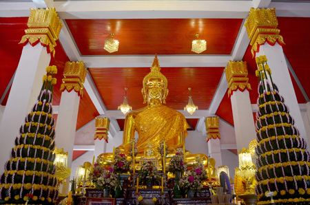 bot: Golden buddha image statue in church thai called Ubosot or bot of Phra That Choeng Chum temple for Thai people and traveler visit and pray in Sakon Nakhon, Thailand