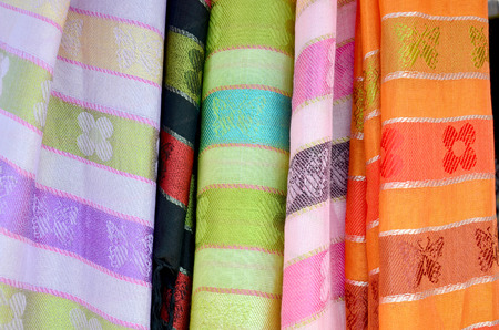 nakhon: Colorful scarf and fabric thai style for sale and local clothes shop in Sakon Nakhon, Thailand