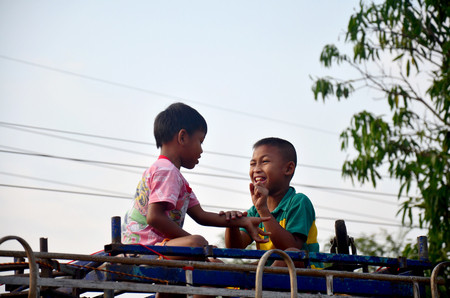 gambling stone: Children thai people playing game Rock Paper Scissors for it on top of car in morning time at Ban Non Hom on January 17, 2016 in Sakon Nakhon, Thailand Editorial
