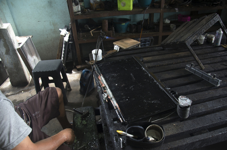solder: Thai people use lead and gas welding for fix and solder radiator of car at local garage at Nonthaburi Thailand