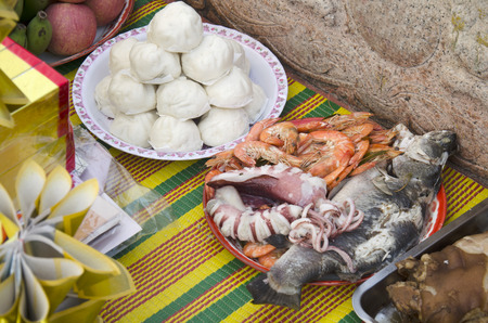 Food and seafood of Sacrificial offering Chinese Culture for ancestors at Sritasala Cemetery Chinese grave at the Qingming Festival day in Ratchaburi,Thailand Stock Photo