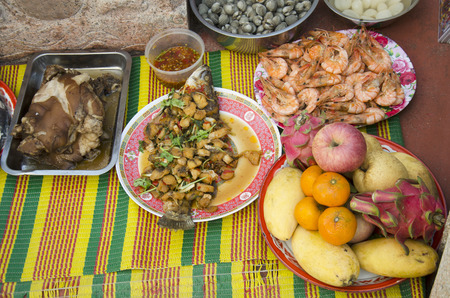 Food set and fruit of Sacrificial offering Chinese Culture for ancestors at Sritasala Cemetery Chinese grave at the Qingming Festival day in Ratchaburi,Thailand Stock Photo