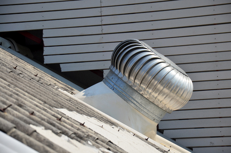 roofing system: Roof Ventilator or air blower on roof of house Stock Photo