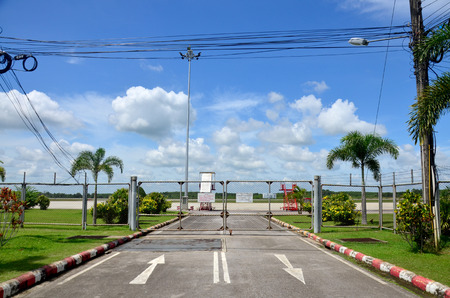 planos electricos: Road and runway with mesh fence of Trang Airport  in Trang, Thailand