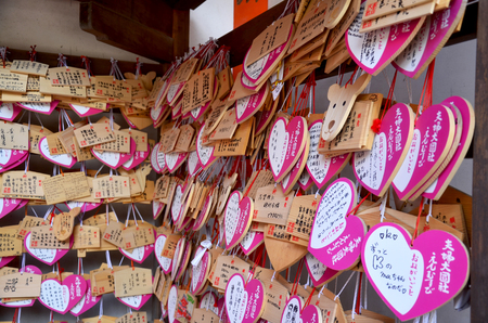 Ema Wood tag or Wooden label for pray for good luck and happy at Kasuga Shrine on July 9, 2015 in Nara, Japan