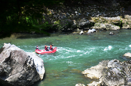 river rafting: Japanese people and traveler foreigner tour rafting by inflatable rubber boat at Hozugawa River between Arashiyama and Kameoka on July 12, 2015 in Kyoto, Japan Editorial