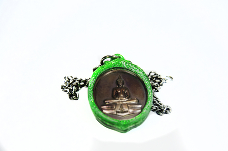 Small Buddha image amulets Phra Phuttha Sothon or Luang Pho Sothon in green plastic frame Stock Photo