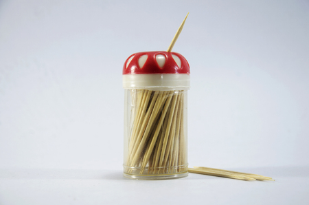 toothpick: Wooden toothpick in plastic box with white background Stock Photo