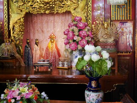 Chinese shrine of Lady princess Soi Dok Mak (Betel Nut Blossom), a local goddess for people praying in Wat Phanan Choeng temple at Ayutthaya, Thailand