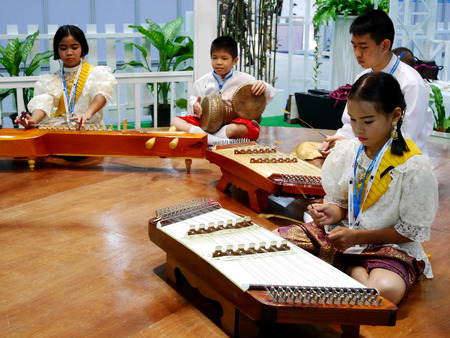 craftmanship: Thai student band playing traditional thai musical instrument concert show people in traditional culture thai festival on November 16, 2016 in Nonthaburi, Thailand