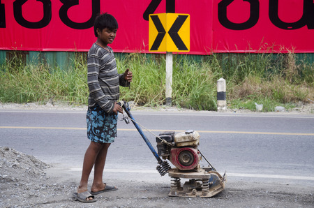 Thai people use soil compactors in construction site working and repair surface of road at  rural roads countrysid on November 27, 2016 in Nonthaburi, Thailand Editorial