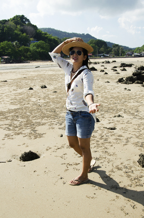 decreased: Asian thai woman posing on the beach in the Andaman ocean while sea water level decreased at Koh Yao Noi in Phang Nga, Thailand Stock Photo