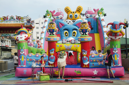 Asian thai children relax playing on inflatable playground or inflatable toy in playground at Tha Nam Non market on July 28, 2016 in Nonthaburi, Thailand