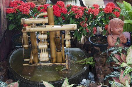 watermill: Turbine baler bamboo and dolls earthenware for decoration in garden at Nonthaburi, Thailand