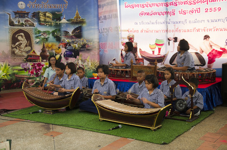 thai musical instrument: Thai students band playing traditional thai musical instruments concert show people in traditional culture thai festival on July 26, 2016 in Nonthaburi, Thailand