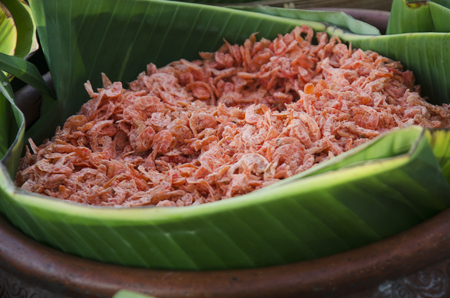 Dried shrimp on banana leaf in basket for cooking thai food for sale at market