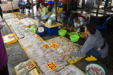 fishery products: Thai people and travellers buy seafood from vendors seafood shop at Ang Sila jetty fish local market on August 11, 2016 in Chonburi, Thailand.