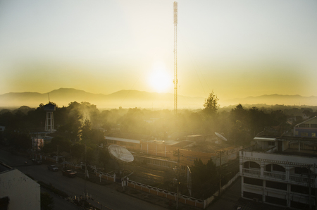 aquifer: Cityscape with traffic road of at tower artesian aquifer and Broadcasting Services station Lampang city in morning time on December 27, 2016 in Lampang, Thailand