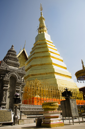 Glod chedi of Wat Phra That Cho Hae temple for people visit and pray at Phrae city on December 29, 2016 in Phrae, Thailand