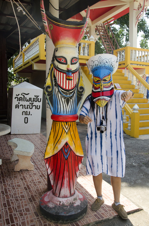 phon: Asian thai woman wearing mask head with costume of Phi Ta Khon dance and playing at Phi Ta Khon Museum in Wat Phon Chai on February 22, 2017 in Loei, Thailand. Editorial