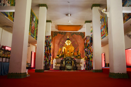 loei: Golden buddha statue in ubosot for people and travellers praying at Wat Phon Chai and travel Phi Ta Khon Museum on February 22, 2017 in Loei, Thailand Editorial
