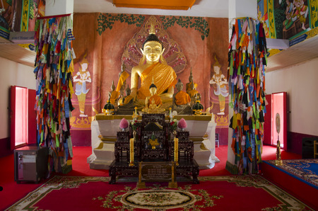phon: Golden buddha statue in ubosot for people and travellers praying at Wat Phon Chai and travel Phi Ta Khon Museum on February 22, 2017 in Loei, Thailand Editorial