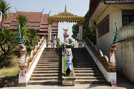 phon: Gate entrance with naga staircase for travelers  people walking go to praying and visit at Phi Ta Khon Museum in Wat Phon Chai on February 22, 2017 in Loei, Thailand.