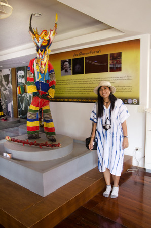 phon: Asian thai woman travelers wearing mask head with costume of Phi Ta Khon dance and playing at Phi Ta Khon Museum in Wat Phon Chai on February 22, 2017 in Loei, Thailand.