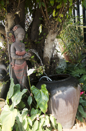 Clay dolls woman statue of gardening decoration in garden at outdoor of home