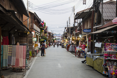Asian thai people and foreigner travelers visit travel and walking shopping on street night market at Chiang Khan in evening time on February 21, 2017 in Loei, Thailand.