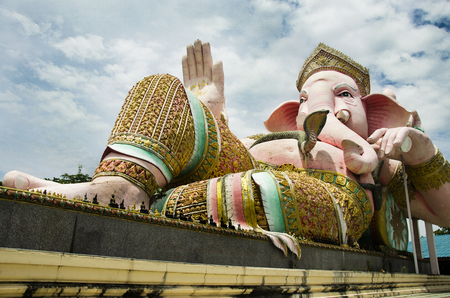 Ganesh statue pink color thai called Phra Pikanet at outdoor for people visit and respect praying at  Lord Ganesha Park on May 9, 2017 in Nakhon Nayok, Thailand