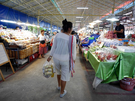 local 27: Asian thai women and people travel and shopping product and food from local shop at Don Wai Floating Market on March 27, 2017 in Nakhon Pathom, Thailand.