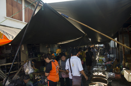 klong: People walking visit and shopping in Mae klong Railway Market or Talat Rom Hup meaning the umbrella pulldown market on April 12, 2017 in Samut Songkhram, Thailand