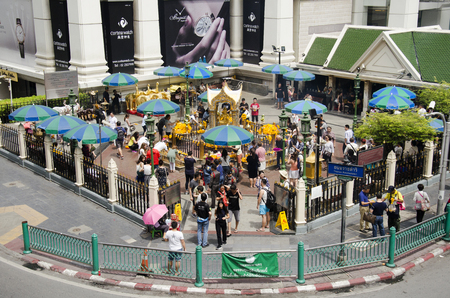 phrom: View of Erawan Shrine and people praying Thao Maha Phrom or Lord Brahma at Ratchaprasong intersection of Ratchadamri Road in Pathum Wan on May 16, 2017 in Bangkok, Thailand