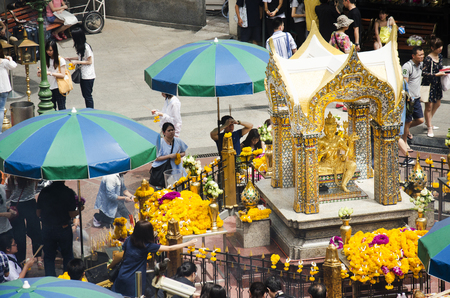 View of the Hindu shrine from BTS Skytrain and Thai and foriener people praying Thao Maha Phrom or Lord Brahma Great at Erawan Shrine on May 16, 2017 in Bangkok, Thailand Editorial