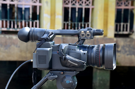 filmmaker: Thai people use Digital Camcorder Video for broadcast live of traditional long boat racing festival at Chaopraya river on November 8, 2015 in Nonthaburi, Thailand