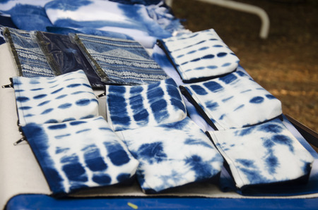 Handmade indigo fabric pocket money souvenirs for travelers people sale at organic street market in Nakhon Ratchasima, Thailand