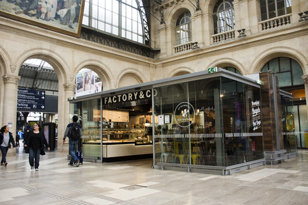 france station: French people and foreigner travlers buy and use service in coffee shop at Gare de Paris-Est or Paris Gare de lest railway station on September 7, 2017 in Paris, France Editorial