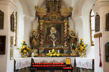 Architecture interior of small church for Swiss people and foreigner travelers praying and visit at Samnaun village on September 2, 2017 in Graubunden, Switzerland