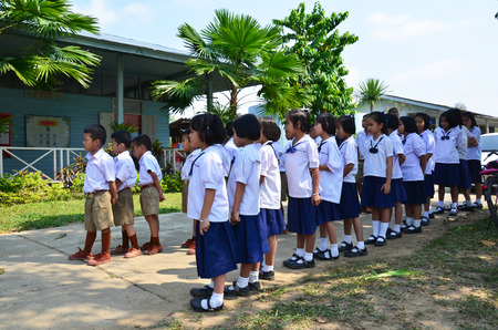Thai children student line up at front of classroom building of Don Moon (ngang) School at countryside Pua District on April 29, 2011 in Nan, Thailand