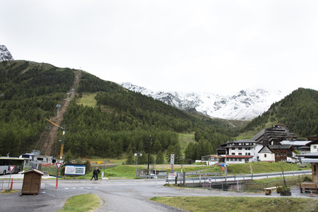 Austrian people and foreigner travelers visit and playing ski with cable car stationat otztal alps mountain in Schnals city on September 2, 2017 in Bolzano, Austria
