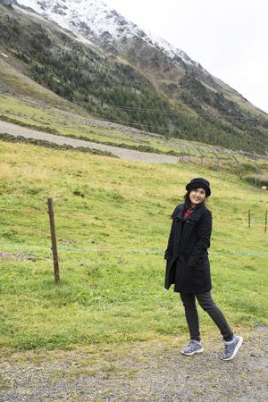 Asian traveler thai woman walkiing and visit Nauders village and otztal alps mountain at Schnals city in Bolzano, Austria