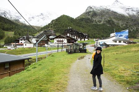 Asian traveler thai woman walkiing and visit Nauders village and otztal alps mountain at Schnals city on September 2, 2017 in Bolzano, Austria Standard-Bild