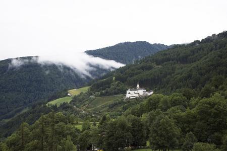 Marienberg Abbey or Abtei Marienberg or Abbazia Monte Maria on mountain at Malles Venosta, in val Venosta, in Trentino-Alto Adige, Italy Reklamní fotografie