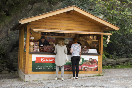 Austrian people and foreigner travelers buying food product and gift souvenir at local shop beside road at Oetztal tiroler village on September 2, 2017 in Tyrol, Austria