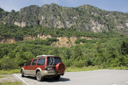 Car stop at parking of Khao Nang Phanthurat or Khao Chao Lai Yai Forest Park in National Parks and Marine Reserves at Cha Am in Phetchaburi, Thailand Stock Photo