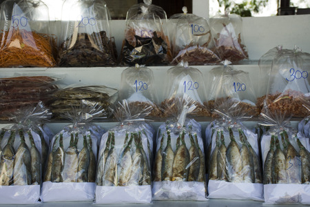 Dried seafood product and souvenir at local shop for sale travelers people in Laem Phak Bia, Phetchaburi, Thailand
