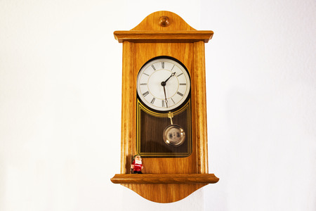 Wooden Classic clock germany style on wall in house on September 9, 2017 in Heidelberg, Germany