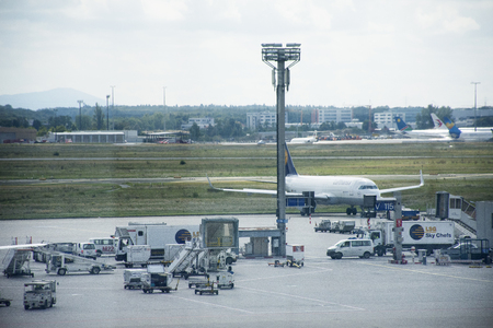 Traffic road and people working checking with airplane takeoff and landing on runway at Frankfurt International Airport on September 10, 2017 in Frankfurt, Germany