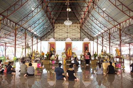 Thai people praying and rite redeem offering with a vow to a Ai Kai Kuman Thong in Wat Chedi at Sichon on January 30,2018 in Nakhon Si Thammarat, Thaliland